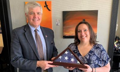 Bentz presents American Flag to veteran Kristin Gyford